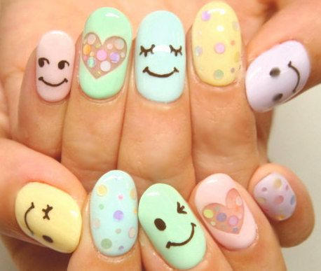 Pastel colored happy face nail design
