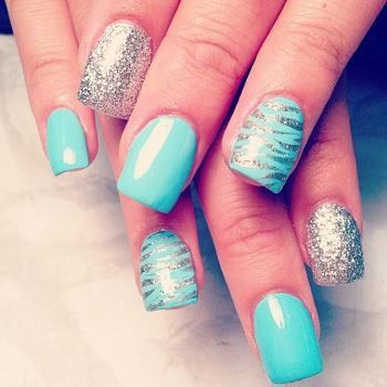 Teal nail with animal print