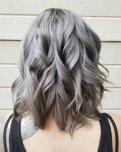 Shoulder length wavy hairstyle for gray hair