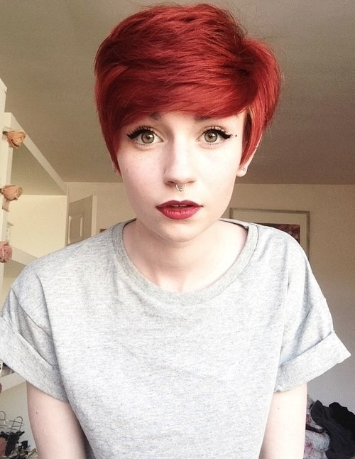 Red pixie haircut with side-swept bangs