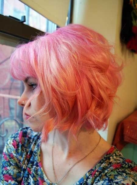Pink colored bob hairstyle for short curly hair