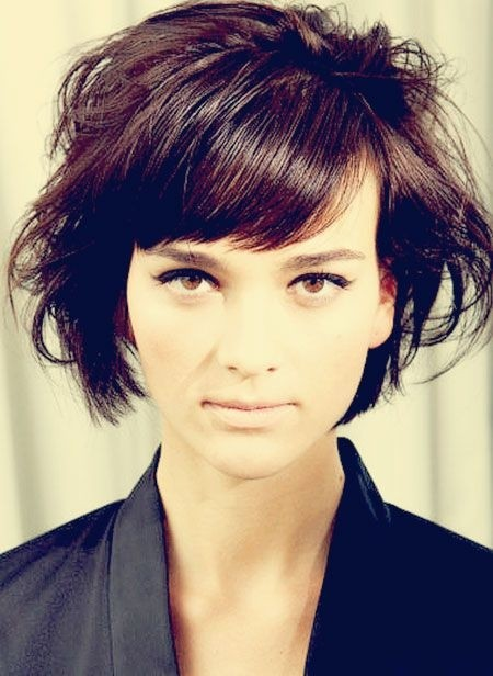 Messy short bob hairstyle with side bangs