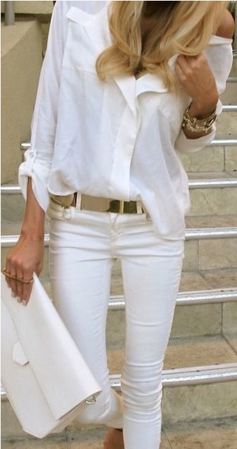 White outfit, white shirt with golden accessories.