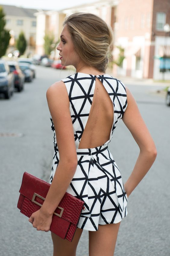 white jumpsuit with black lines over