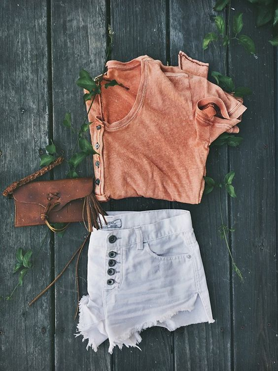 Orange top and pale shorts over