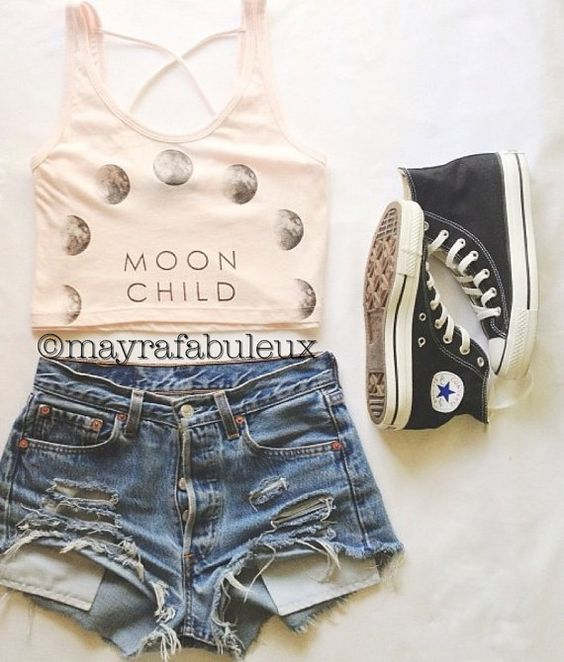 Polka dot top and ripped shorts over