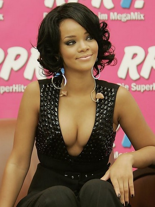 "Rihanna Short Layered Black Curly Hairstyle for Black Women"" width=""465"