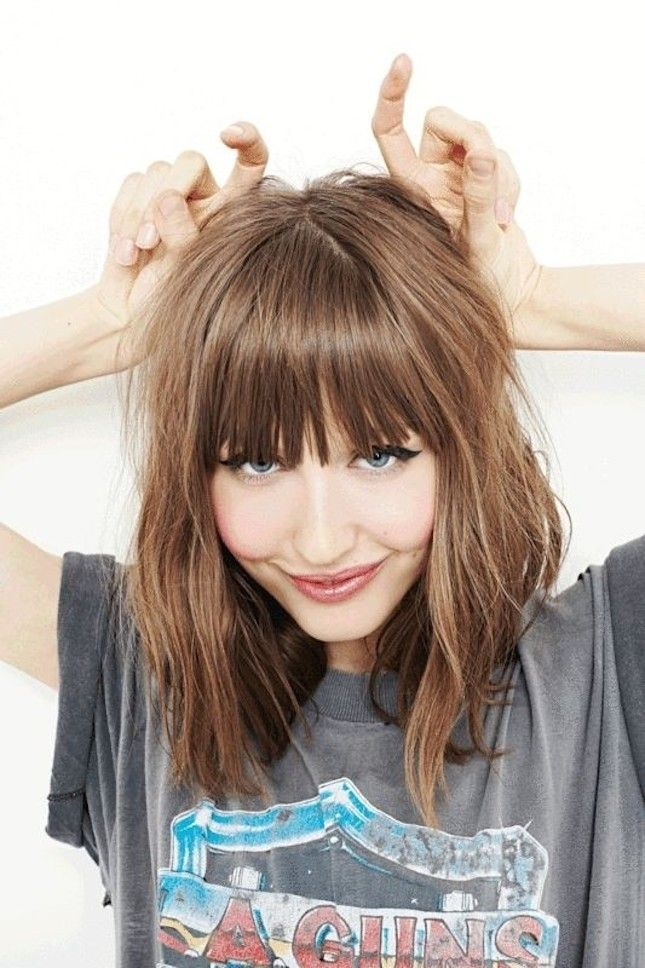 Medium wave hairstyle with blunt bangs