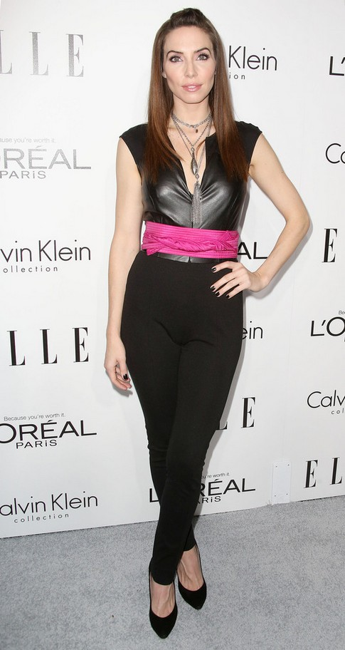 Whitney Cummings tight fitting black leather jumpsuit