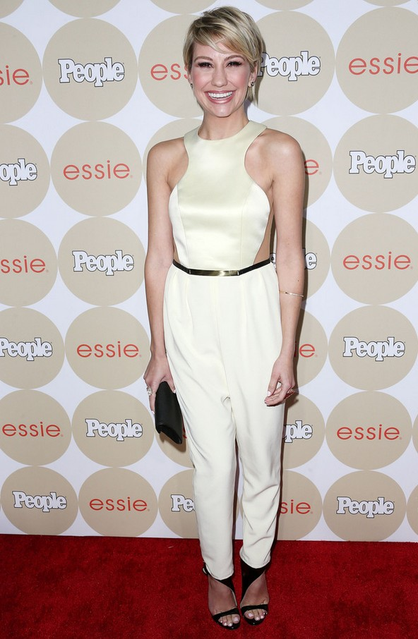 Sleeveless white jumpsuit by Chelsea Kane with transparent side walls