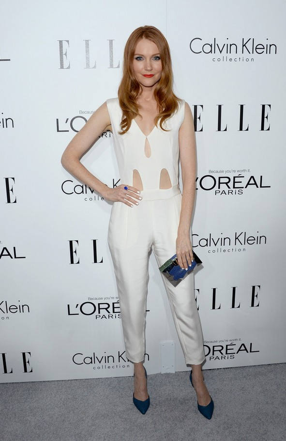 Sleeveless white jumpsuit by Darby Stanchfield with peekaboo details
