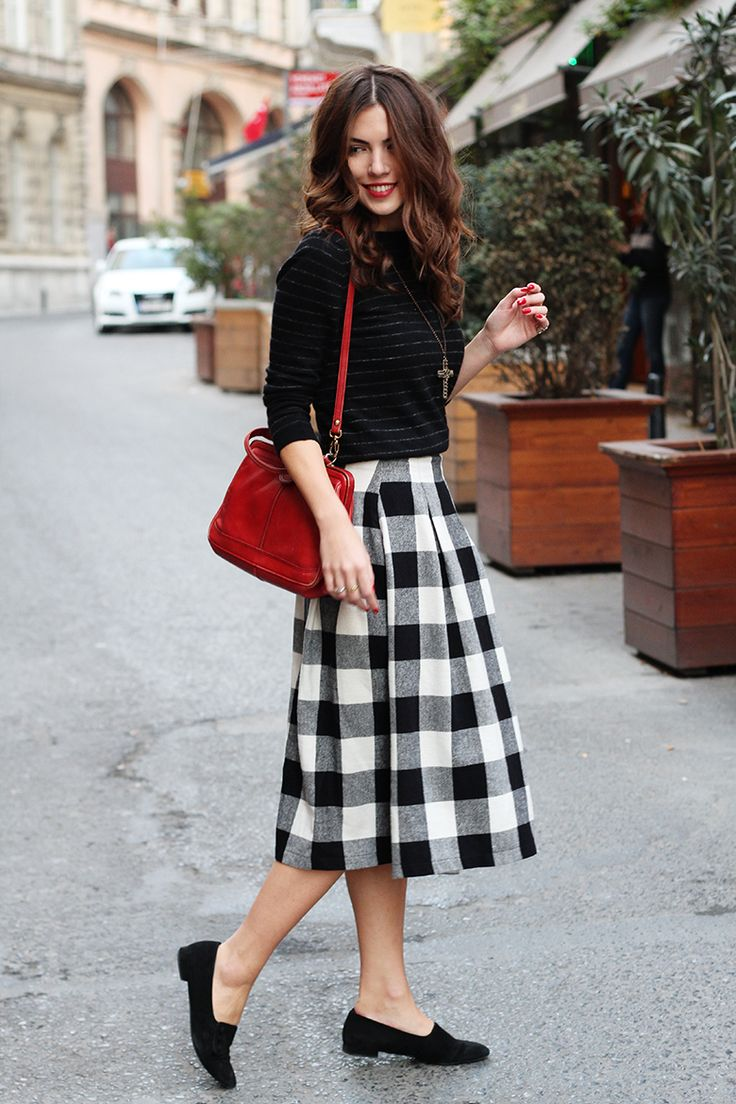 Plaid skirt and black loafers
