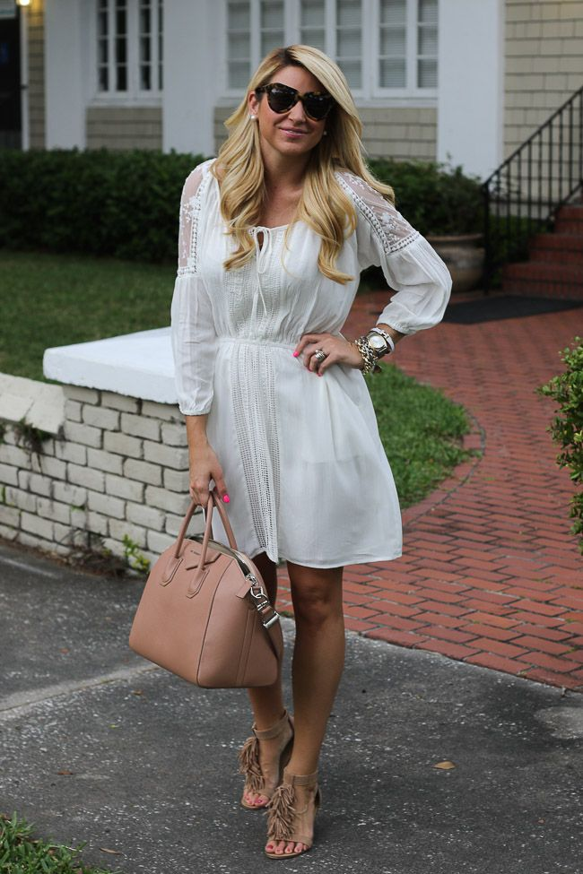White dress, brown fringed sandals and brown bag