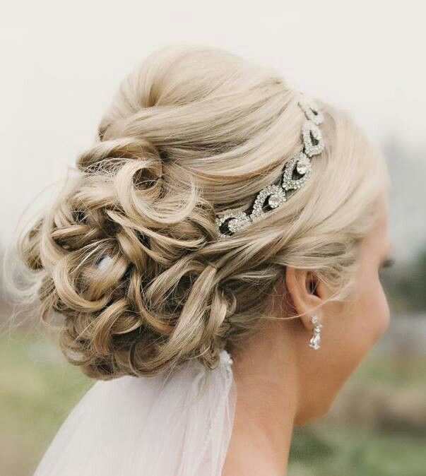 Beautiful wedding updo with crystal headband and veil