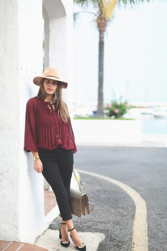 Burgundy top and black pants over