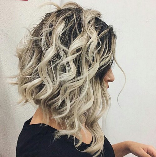 Medium wave hairstyle with highlights