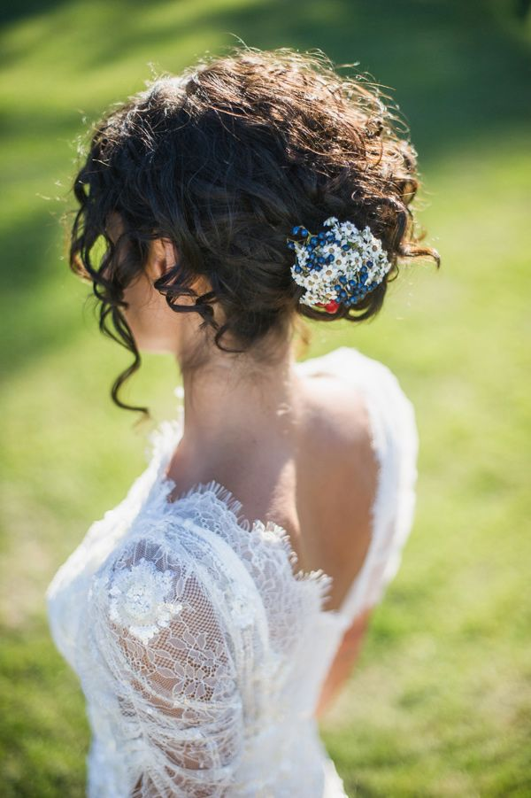 Black curly updo wedding hairstyle