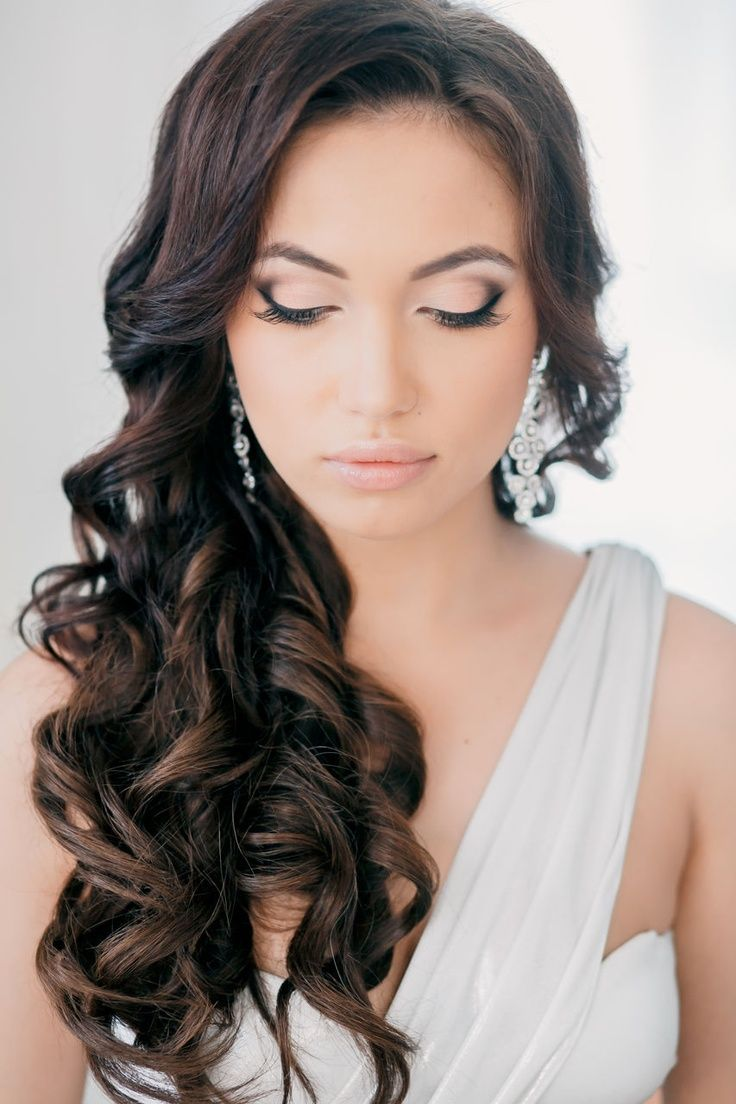 Large long brunette curly wedding hairstyle