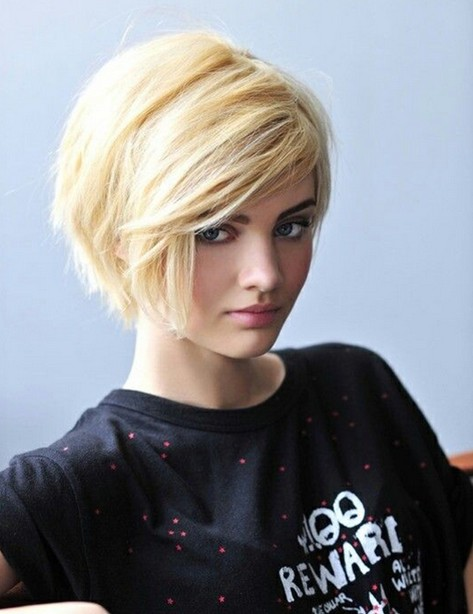 Short blonde haircut with side-swept bangs