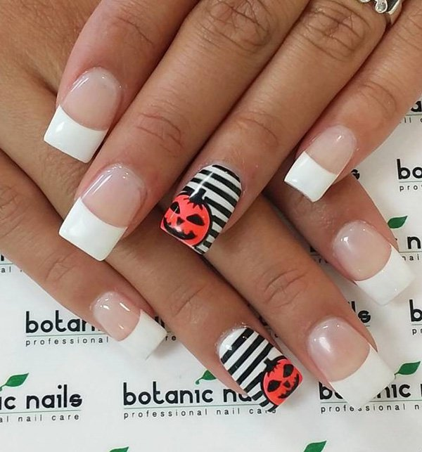 Pumpkin-and-stripe nails over