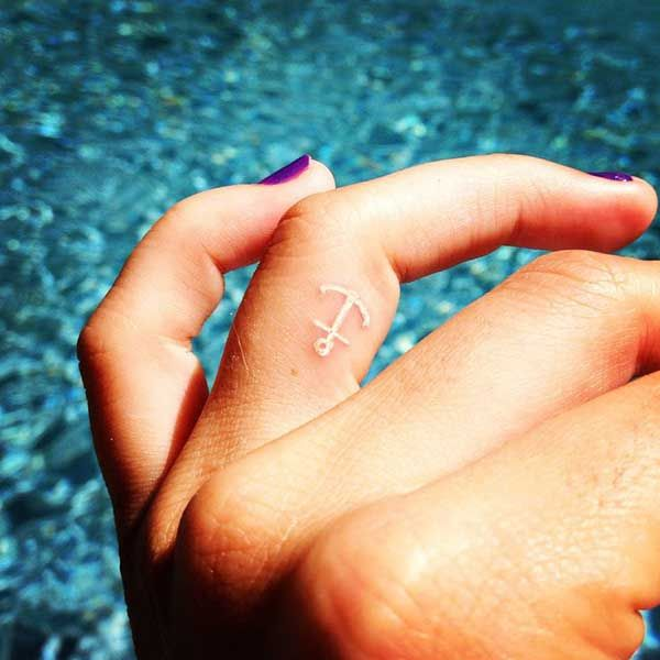 Anchor tattoo on finger