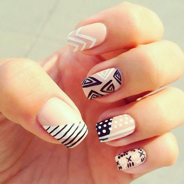 Black and white tribal nail design