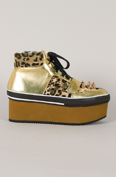 Side view of the studded leopard flatform sneaker