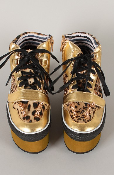 Front view of the studded leopard flatform sneaker