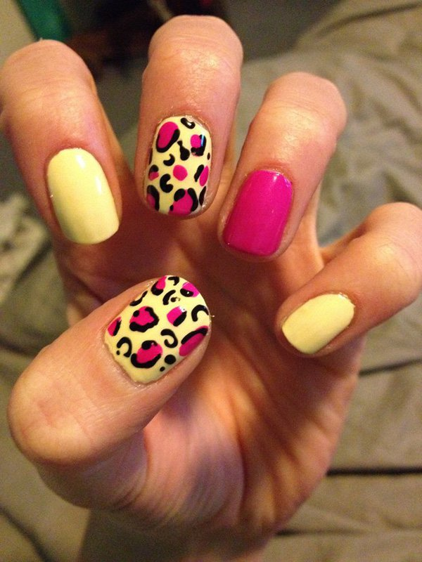 White and pink nail design with leopard print