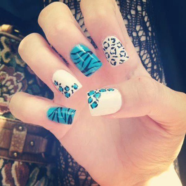 White and blue nail design with leopard print