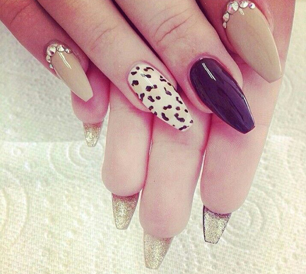Stiletto nail design with leopard print