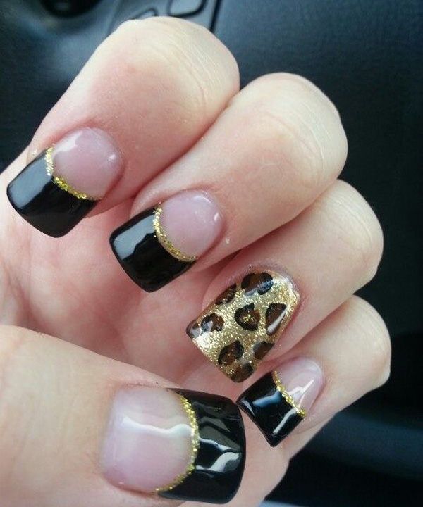 Black and gold nail design with leopard print
