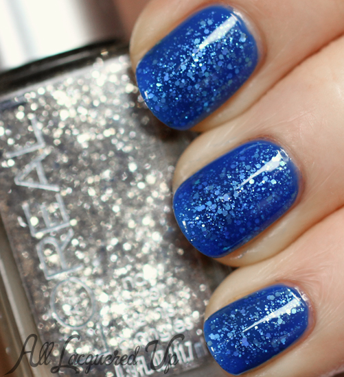 Deep blue nails with glitter