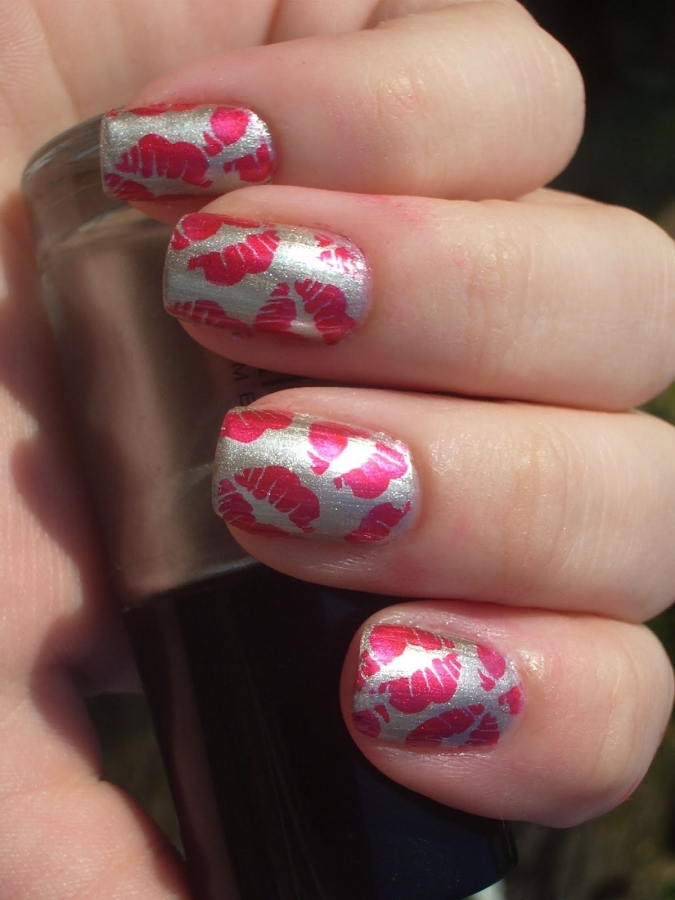 Pink kisses on the nails