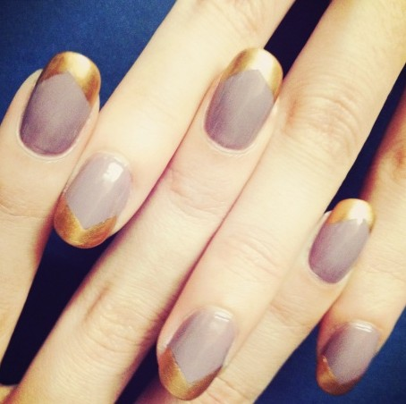 Simple lavender with asymmetrical gold tip nail design