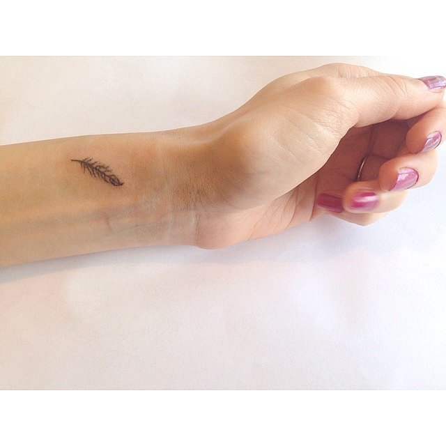 Little-feather tattoo for women