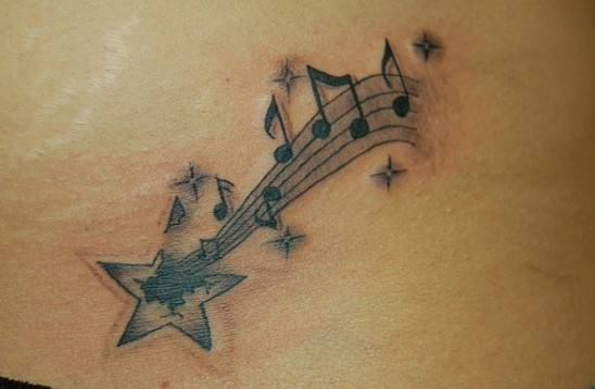 Star tattoo designs: shooting star with music notes tattoo