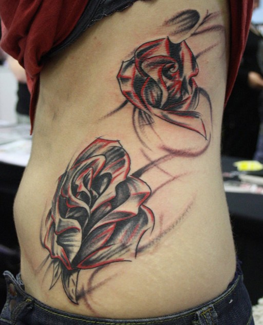 Rose tattoo on the side of the body