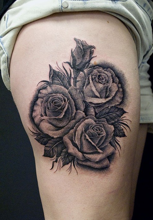Rose tattoo: black and gray thigh