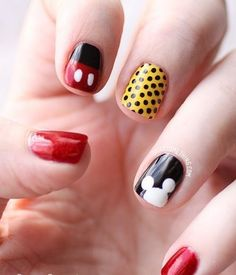 Bright colored Mickey Mouse nails