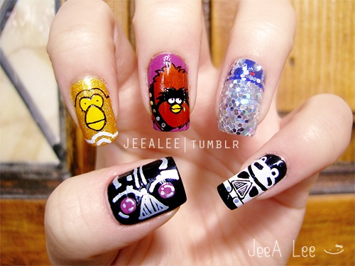 Glittering angry bird nail design