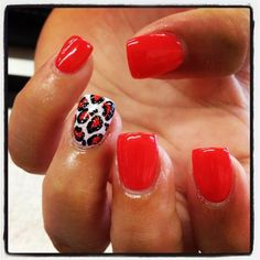 Red nails with leopard motifs