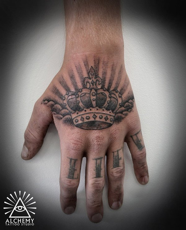 Cool crown tattoo on hand for men