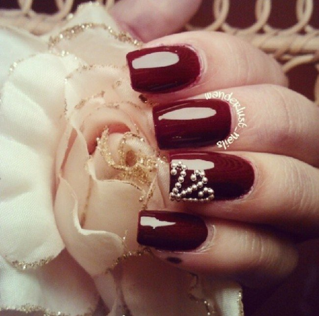 """Burgundy Nail Design With Pearls """"width ="""" 450 """"srcset ="""" https://lilostyle.com/wp-content/uploads/2020/02/1582807472_238_30-Amazing-Burgundy-Nail-Designs-for-Women-2019.jpg 650w, http: / /www.lilostyle.com/wp-content/uploads/2014/07/Burgundy-Nail-Design-With-Pearls-120x120.jpg 120w """"sizes ="""" (max-width: 650px) 100vw, 650px"""