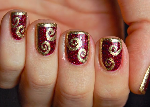 """Burgundy Nail Design With Gold Swirl """"width ="""" 450"""