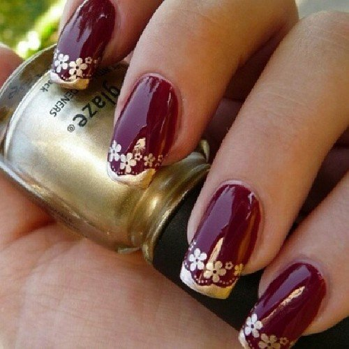 """Burgundy Nail Design With Floral Print """"width ="""" 450 """"srcset ="""" https://lilostyle.com/wp-content/uploads/2020/02/1582807473_796_30-Amazing-Burgundy-Nail-Designs-for-Women-2019.jpg 500w, https://www.lilostyle.com/wp-content/uploads/2014/07/Burgundy-Nail-Design-With-Floral-Print-200x200.jpg 200w, https://www.lilostyle.com/wp-content /uploads/2014/07/Burgundy-Nail-Design-With-Floral-Print-120x120.jpg 120w """"sizes ="""" (max-width: 500px) 100vw, 500px"""