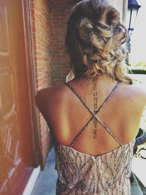 Back written tattoo