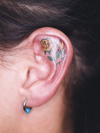 Flower inner ear tattoo