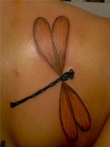 Dragonfly tattoo on the back