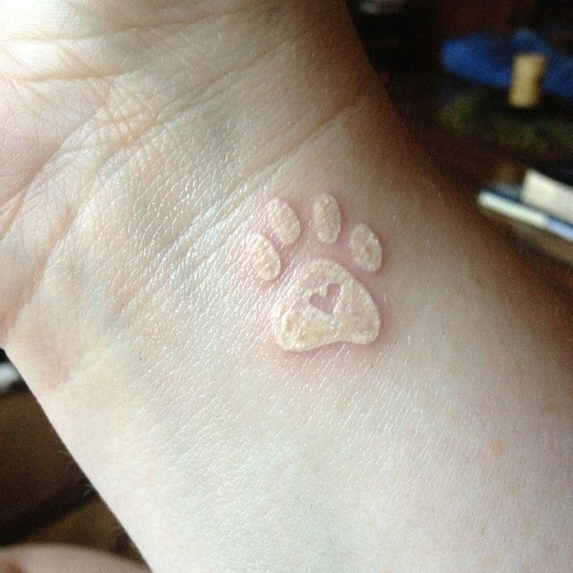 White Dog Paw Tattoo